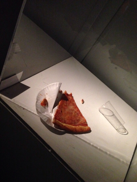 someone actually tried to eat the 4 days old pizza that was exhibited